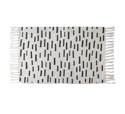 Tapis déco à franges blanc avec motifs noirs en coton 90x60cm