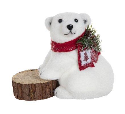Figurine ours blanc assis avec pattes avant sur tronc d'arbre H 21cm