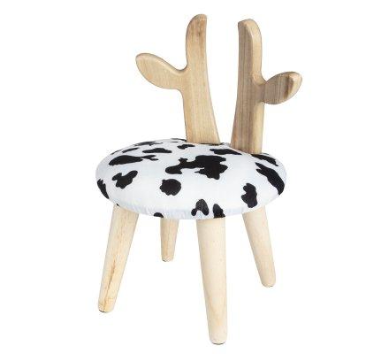 Petit tabouret avec cornes en pin et effet fourrure de vache noir et blanc H45xD30cm